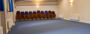 Landford Village Hall blue Room with stacked chairs